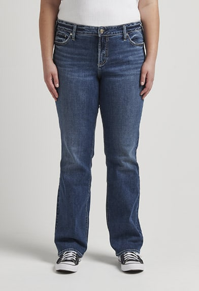 Plus size curvy relaxed fit slim bootcut jeans featuring a mid rise and medium indigo wash