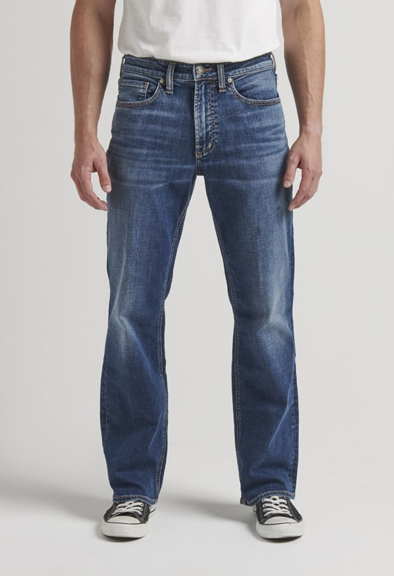 Men's loose fit straight leg jeans with a dark indigo rinse