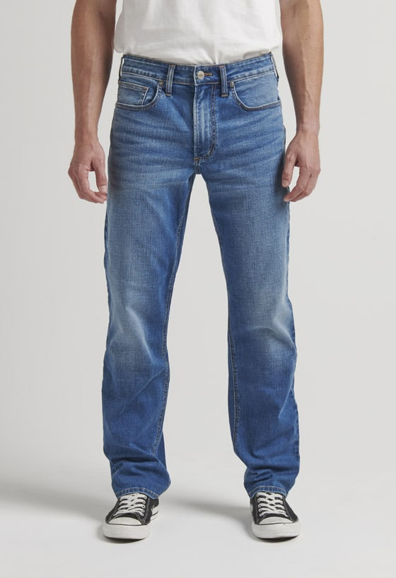 Men's relaxed fit tapered leg jeans with a medium indigo wash