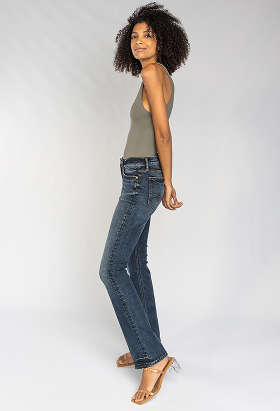 Women's curvy relaxed fit slim bootcut jeans featuring a mid rise and dark indigo wash