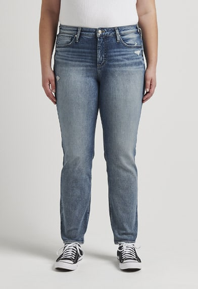 Plus size mid rise skinny jeans in white featuring a universally flattering fit
