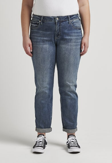 Plus size relaxed fit boyfriend jeans featuring a mid rise and dark indigo wash