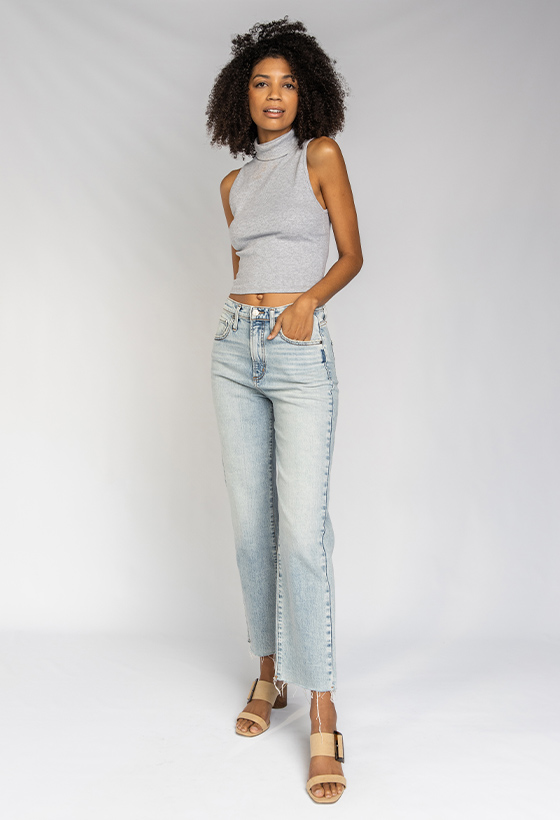 Women's vintage fit straight leg jeans featuring a super high rise and light indigo wash